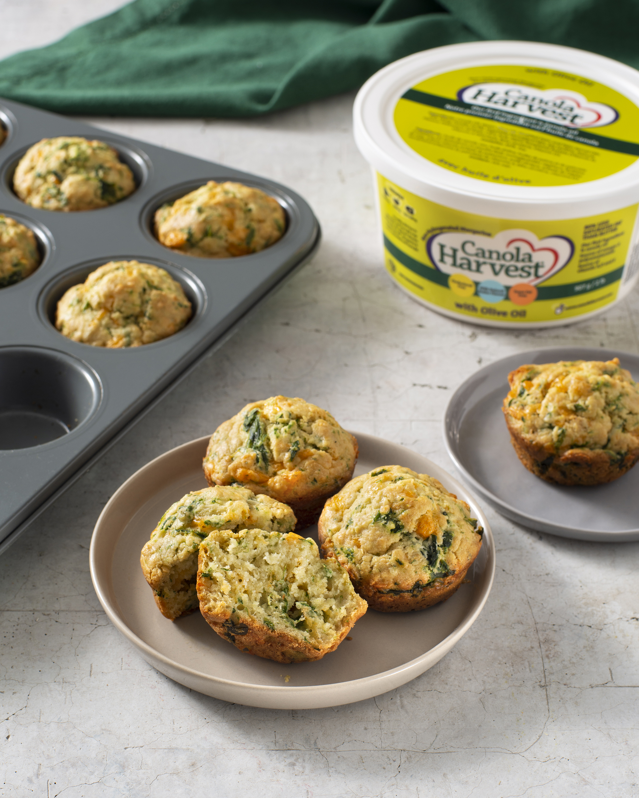 A photo of the cheese and spinach muffins with Canola Harvest margarine with olive oil.