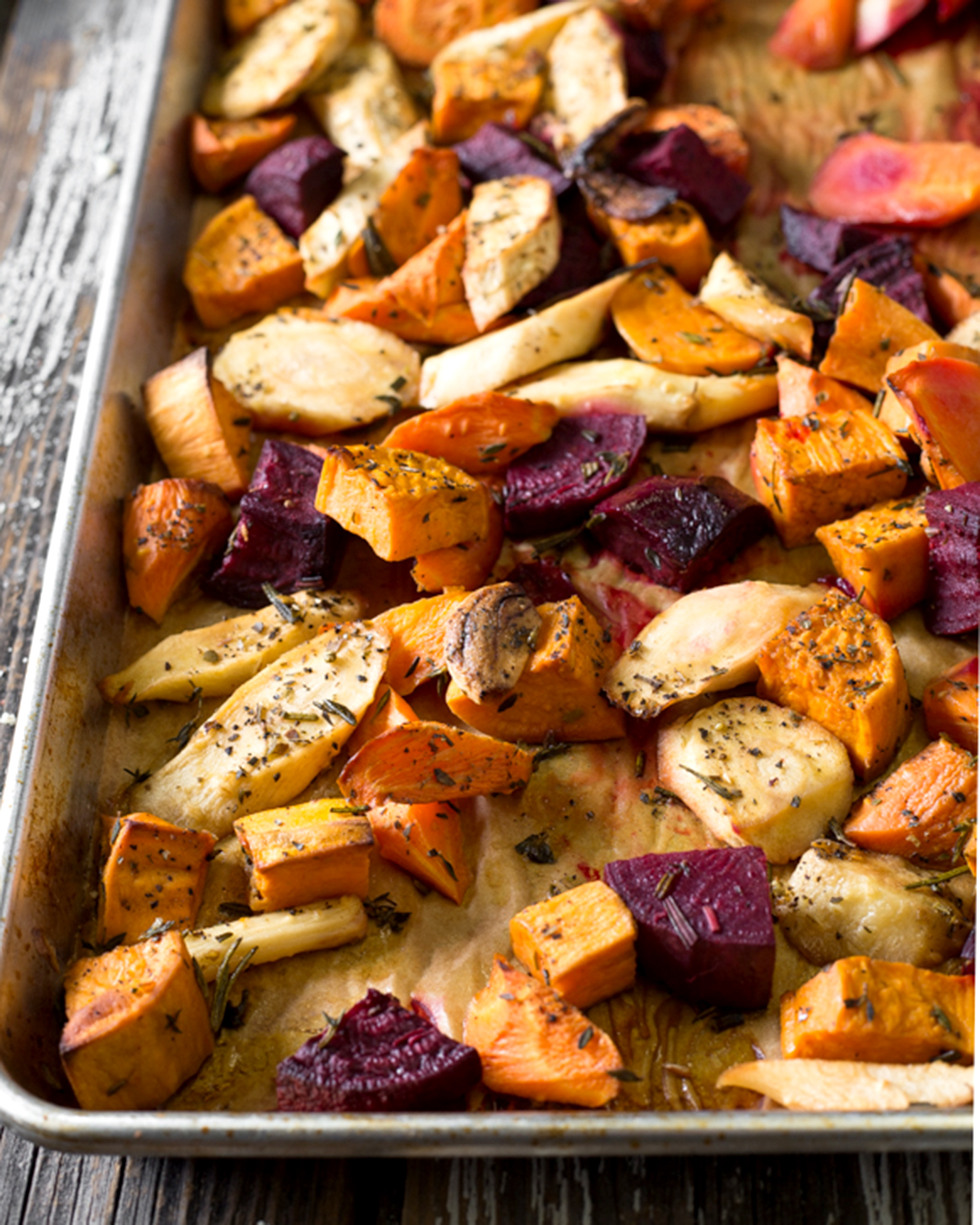 A photo of an finished sheet of our herb roasted root vegetable recipe.