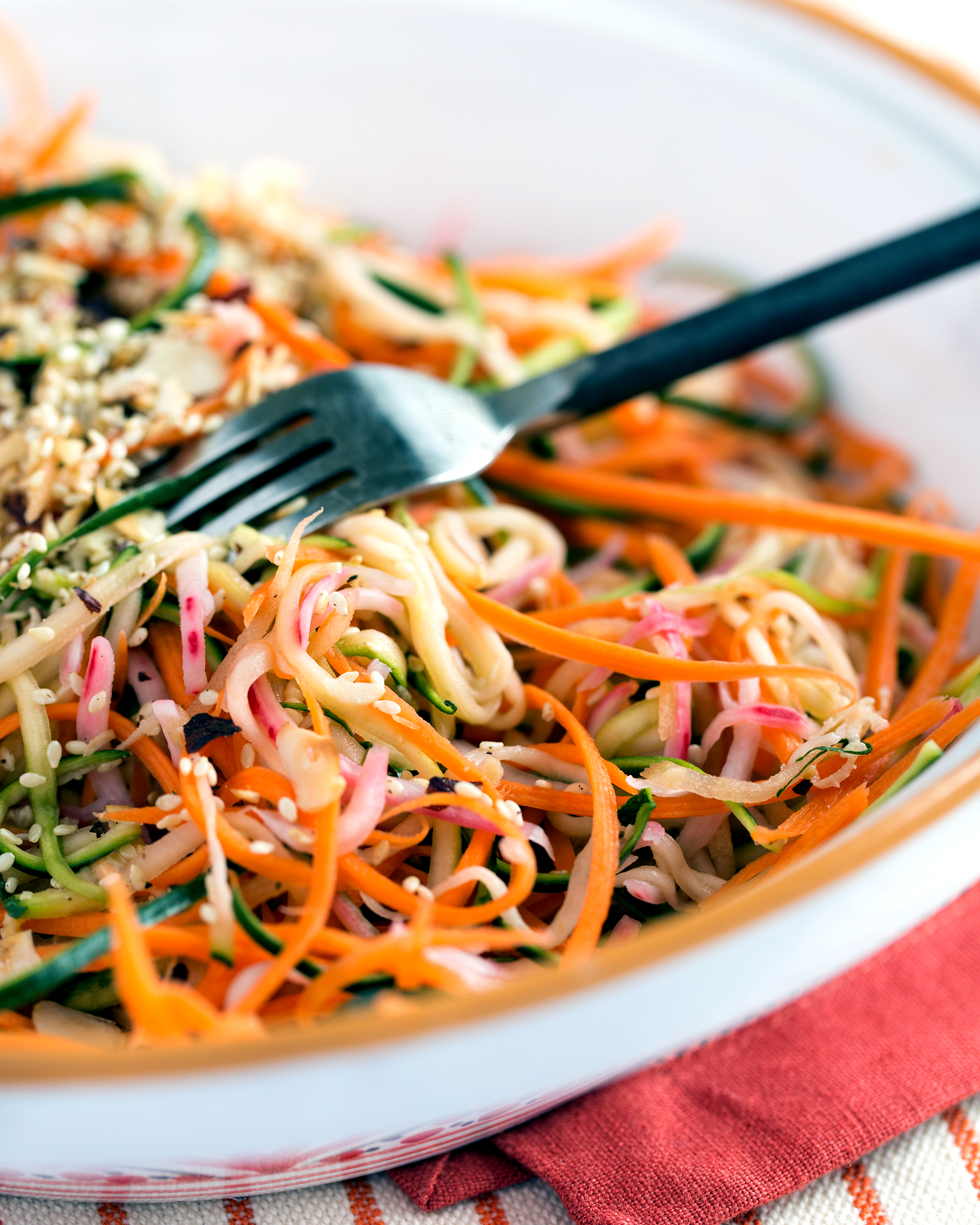 A close-up photo of a finished plate of spiralized veggie salad recipe.
